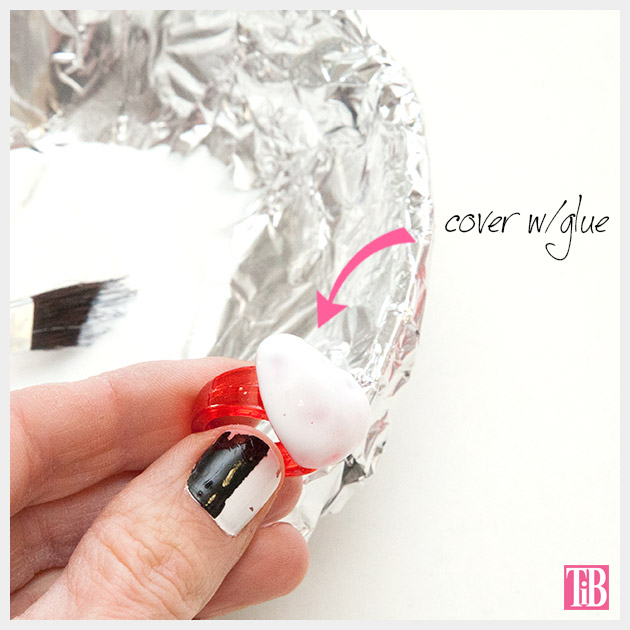 Adding glue to your Valentine Heart Rings DIY