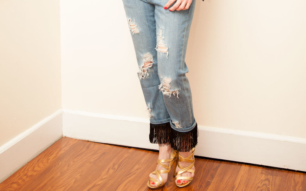 DIY distressed jeans with fringe added to the cuffs